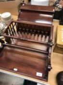 Two modern mahogany book troughs,