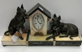 A 1930s marble and onyx cased clock garn