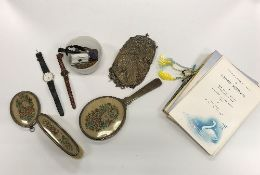A box containing various costume jewelle