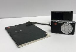 A Leica C-Lux I camera with leather case