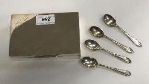 A rectangular silver sheathed cigarette