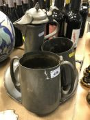 A pewter flagon, two twin-handled pewter