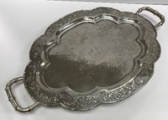 """A circa 1900 Chinese silver shaped oval tray with central inscription """"CEG"""" within an oval,"""