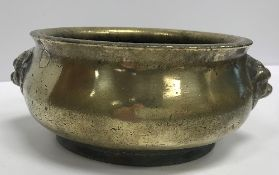 A Chinese bronze censer with stylised li