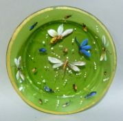 A Victorian green glass circular plate polychrome enamelled in colours with insects and white