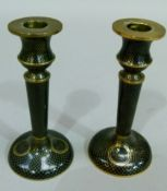A pair of black ground cloisonne candlesticks, 14.5cm high