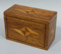 A two division tea caddy with fruitwood inlay, 19cm wide