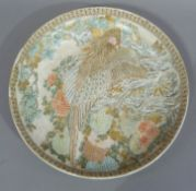 A Japanese Satsuma charger decorated with an exotic bird amidst chysanthemums, 31cm diameter