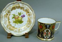 A Hamilton Derby Imari pattern mug, 7cm high and a Spode plate decorated with fruit, 16cm diameter