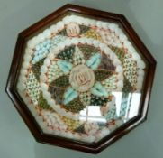 A reproduction Valentines shell display in an octagonal glazed case with brass hanging loop,