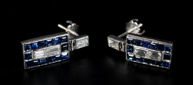 A PAIR OF ART DECO SAPPHIRE AND DIAMOND EARRINGS in 18ct white gold, each pave set with two baguette