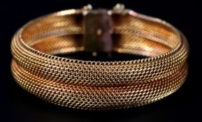 A BRACELET in 14ct gold c.1950 of twin Milanese mesh, approximate weight 49gm