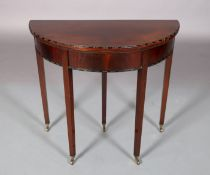 AN EDWARD VII MAHOGANY CARD TABLE in George III style, the D-shaped top with bead and reel carved