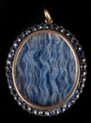 AN EDWARD VII SILVER AND GOLD (tests as 14ct) OVAL PENDANT with vacant centre surrounded by border