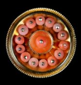 A MID VICTORIAN CORAL SET SHIELD BROOCH in 15ct gold, the 3mm coral beads post mounted to the centre