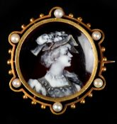 A 19TH CENTURY ENAMEL AND SEED PEARL BROOCH in 15ct gold, the circular black and white champlevé