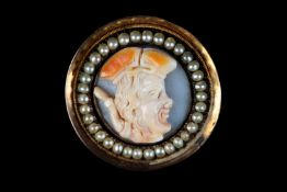 A 19TH CENTURY SHELL CAMEO AND SEED PEARL BROOCH in 9ct gold the circular portrait set within a seed