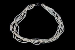A FRESH WATER CULTURED PEARL NECKLACE, the six rows of 3.6mm pearls gathered and fastened with