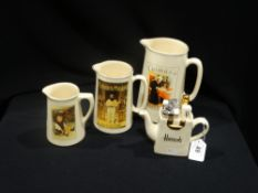 A Set Of Three Graduated Mustard Advertising Jugs, Together With A Novelty Teapot