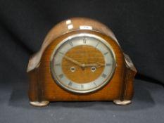 A Polished Oak Encased Mantel Clock With Circular Dial
