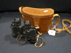 A Pair Of Cased Dollond Binoculars