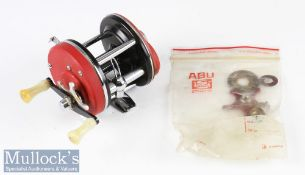 Early Abu Garcia Sweden Ambassadeur 4000 multiplier reel - red with twin white handles, foot stamp