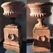 PAIR OF STONEWARE CAMPANA URNS each with lobed and reeded bodies, and raised on oblong bases with