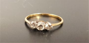 GRADUATED DIAMOND THREE STONE RING the diamonds totaling approximately 0.35cts, on unmarked gold
