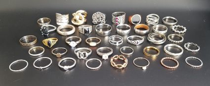 SELECTION OF SILVER AND OTHER RINGS of various sizes and designs, including gem and stone set