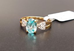 CERTIFIED BLUE AND WHITE ZIRCON RING the central Ratanakiri blue zircon weighing 1.97cts flanked