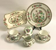 HARLEQUIN PART DINNER SERVICE decorated in the Indian Tree pattern and comprising eight soup