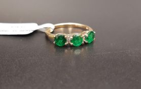CERTIFIED EMERALD AND DIAMOND RING the three round cut Luhlaza emeralds totaling 1.05cts separated