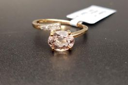 KUNZITE AND DIAMOND RING the Brazilian oval cut Minas Gerais kunzite weighing 1.61cts, with diamonds