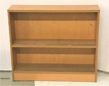 LIGHT OAK OPAEN BOOKCASE with two shelves, one adjustable, standing on a plinth base, 100cm wide