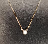DIAMOND SET NECKLACE the solitaire diamond approximately 0.1cts, on eighteen carat gold chain, total