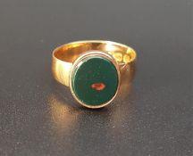 BLOODSTONE SIGNET RING on fifteen carat gold shank, ring size K