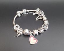 PANDORA MOMENTS SILVER CHARM BRACELET with a good selection of eleven charms including gem set