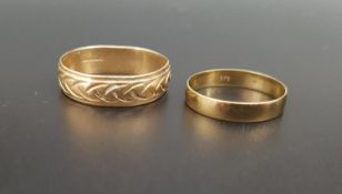 TWO NINE CARAT GOLD WEDDING BANDS the larger example with engraved decoration, ring sizes T and N,