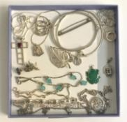 GOOD SELECTION OF SILVER JEWELLERY including silver pendants on chains; a CZ set bangle; two pairs