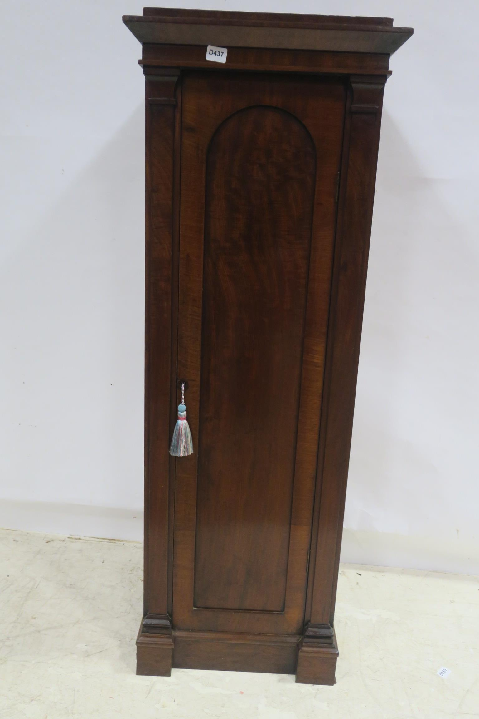 Lot 295 - A 19TH CENTURY MAHOGANY CUPBOARD the square stepped top above a rectangular arch panelled door