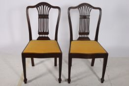 A PAIR OF 19TH CENTURY HEPPLEWHITE DESIGN MAHOGANY SIDE CHAIRS each with a shaped top rail and