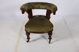 A 19TH CENTURY MAHOGANY AND UPHOLSTERED TUB SHAPED LIBRARY ARMCHAIR the button upholstered back and