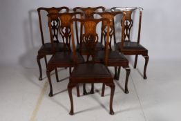 A SET OF SIX 19TH CENTURY MAHOGANY INLAID DINING CHAIRS each with a shaped top rail and pierced