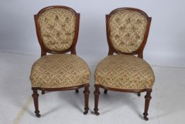 A PAIR OF 19TH CENTURY SATINWOOD SIDE CHAIRS each with an arched top rail and button upholstered