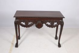 A CHIPPENDALE DESIGN MAHOGANY SIDE TABLE the rectangular top with gadrooned rim above a shell and