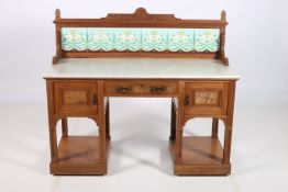 AN ARTS AND CRAFTS MAHOGANY AND WALNUT WASH STAND the superstructure with tiled panels above a
