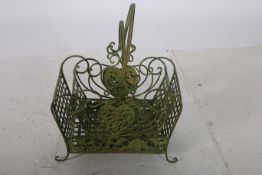 TWO WROUGHT IRON BASKETS each with lattice work panels and carrying handles on scroll legs the