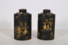 A PAIR OF JAPANNED LIDDED JARS each of cylindrical form decorated with figures flowerheads foliage
