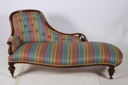 A 19TH CENTURY MAHOGANY CHAISE LONGUE the shaped top rail with button upholstered back and seat