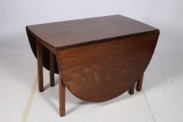 A VERY FINE GEORGIAN MAHOGANY DROP LEAF TABLE the oval hinged top above a moulded apron on square